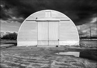 Quonset & Storm Clouds